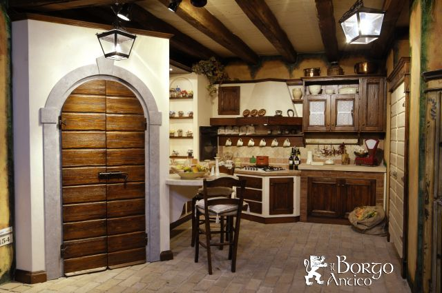 Originale ed eccentrica cucina in muratura - Lampadari cucina rustica ...