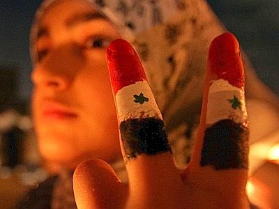 siria donna protesta xin 400x300