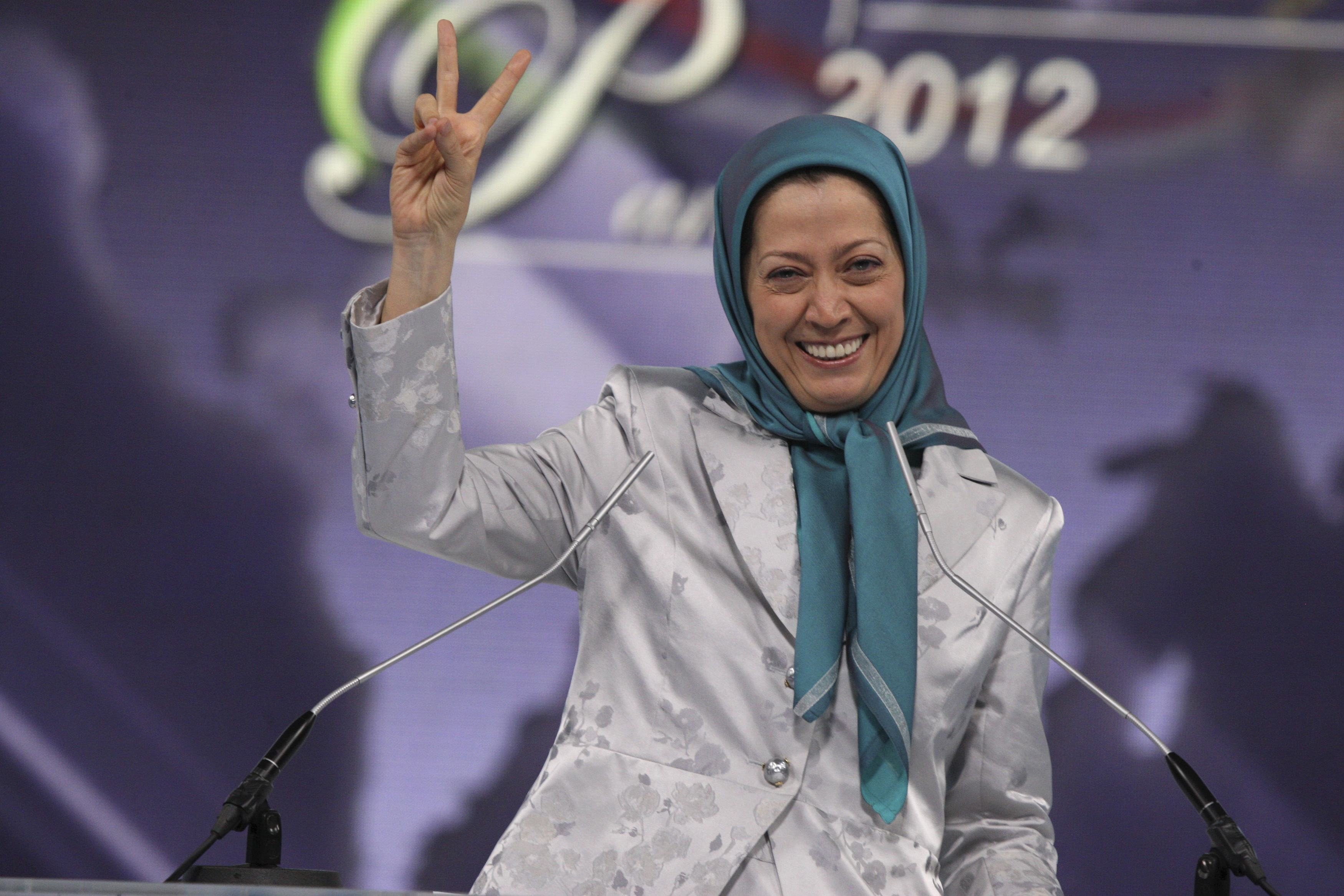 Rajavi, who heads NCRI, gestures as she attends a rally in Villepinte