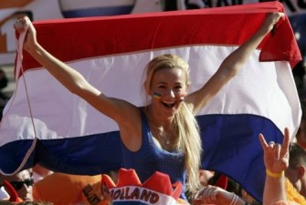 Netherlands soccer fan shouts slogans at the Euro 2012 fan zone in Kharkiv