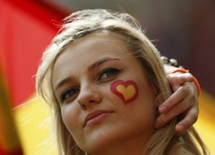 Spanish supporter with a heart in the Spanish colours painted on her cheek waits for the start of the Group C Euro 2012 soccer match between Spain and Italy at the PGE Arena in Gdansk