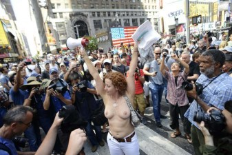 Activist Karen Heaven leads a rally, to protest for the right of women to go topless anywhere a man is able to, in New York