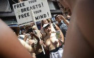 Activists march in a rally, to protest for the right of women to go topless anywhere a man is able to, in New York