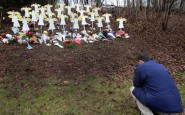 ap newtown man paying respects 121219 wg 185x115