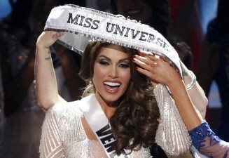 Miss Venezuela Gabriela Isler reacts as she is given the winner's sash after winning the Miss Universe pageant in Moscow