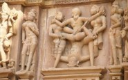 6099641 sculptures of loving couples illustrating the kama sutra on walls of kandariya mahadeva temple at kh