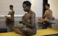 Vanessa Kennedy assumes a position during the Bold & Naked yoga class in New York