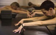 Monika Werner, co-owner of Bold & Naked and yoga instructor, assumes a position during a naked yoga session in New York