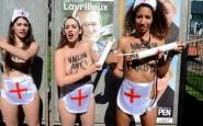 des-militantes-femen-devant-une-affiche-de-marine-le-pen-le-_1606081