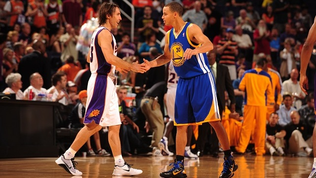 PHOENIX - OCTOBER 19: Steve Nash #13 of the Phoenix Suns greets Stephen Curry #30 of the Golden State Warriors before the opening jump ball in a preseason NBA game on October 19, 2010 at U.S. Airways Center in Phoenix, Arizona. NOTE TO USER: User expressly acknowledges and agrees that, by downloading and or using this Photograph, user is consenting to the terms and conditions of the Getty Images License Agreement. Mandatory Copyright Notice: Copyright 2010 NBAE (Photo by Barry Gossage/NBAE via Getty Images) *** Local Caption *** Steve Nash;Stephen Curry