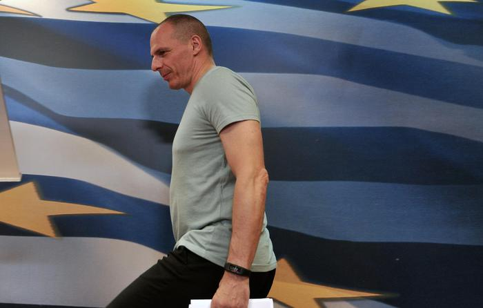 Greece's Finance Minister Yanis Varoufakis arrives for statements after the results of referendum in Athens, Sunday, July 5, 2015. Greece faced an uncharted future as its interior ministry predicted Sunday that more than 60 percent of voters in a hastily called referendum had rejected creditors' demands for more austerity in exchange for rescue loans. (ANSA/AP Photo/Angelos Christofilopoulos)