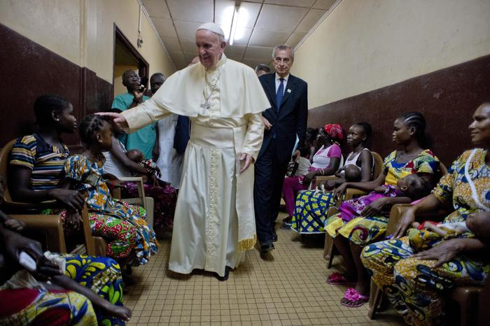 Pope Francis meets children during a brief unscheduled stop at a pediatric hospital on his way to Bangui cathedral, Central African Republic, Sunday, Nov. 29, 2015. Pope Francis is in Africa for a six-day visit that is taking him to Kenya, Uganda and the Central African Republic.(L'Osservatore Romano/Pool Photo via AP)