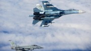 A photo made available by the British Ministry of Defence 18 June 2014 shows the moment an Royal Air Force Typhoon fighter (bottom left) shadowed one of four Russian Sukhoi Su27 Flanker fighters in Baltic air space 17 June 2014.   ANSA /CROWN COPYRIGHT RESERVED  HANDOUT EDITORIAL USE ONLY/NO SALES