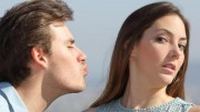 ER8GE7 Friend zone concept with a man trying to kiss a woman and she rejecting him