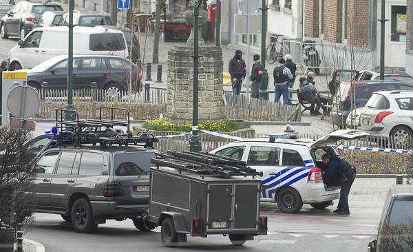 Police cordon off an area in Brussels Tuesday March 15, 2016, after police launched an anti-terror raid linked to last year's Paris attacks in a Brussels neighborhood and three police officers were slightly injured when shots were fired, officials said. A police official, who requested anonymity because the operation was still ongoing, said the exact circumstances of the incident were still unclear, or whether the police officers were struck by bullets or injured in another way. (ANSA/AP Photo/Thierry Monasse)
