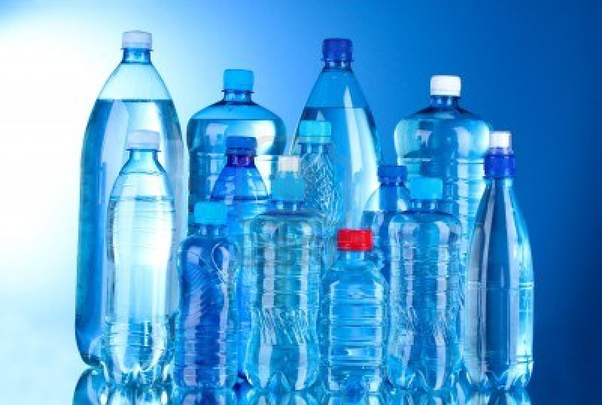 10534717 group plastic bottles of water on blue background