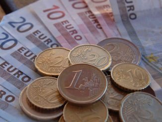 Euro coins and notes.