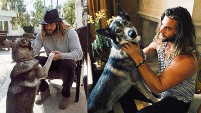 Brock mentre gioca con il suo cane lupo