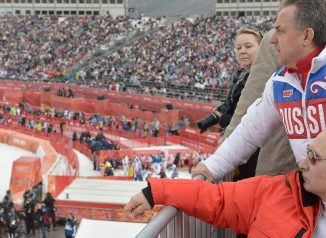 FILE - In this file photo taken Saturday, March 8, 2014, Russian President Vladimir Putin, foreground, watches downhill ski competition of the 2014 Winter Paralympics in Roza Khutor mountain district of Sochi, Russia, as Russia's sports minister Vitaly Mutko stands behind. On Monday, July 18, 2016 WADA investigator Richard McLaren confirmed claims of state-run doping in Russia. (AP Photo/RIA-Novosti, Alexei Nikolsky, Presidential Press Service)