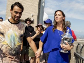 Flavia Pennetta of Italy, holds her women's U.S. Open Tennis champion trophy, as she leads her fiancé, tennis player Fabio Fognini, during a photo call at the Top of the Rock in New York, September 13, 2015. Pennetta won her first grand slam singles title over Roberta Vinci in an improbable all-Italian U.S. Open final on Saturday then added one more shock to a stunning fortnight by announcing her retirement. REUTERS/Brendan McDermid