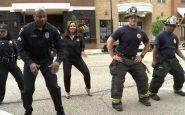 Pompieri e poliziotti scendono in strada e ballano insieme