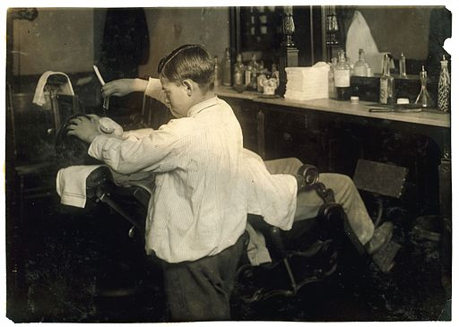 Lewis_Hine,_Frank_De_Natale,_12-year_old_barber,_Boston,_1917